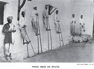 Kunbi - Kunbi Hindu boys on stilts during the Pola festival.