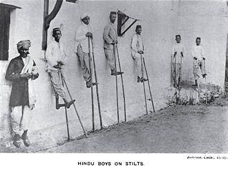Kunbi - Kunbi Hindu boys on stilts during the Pola festival.