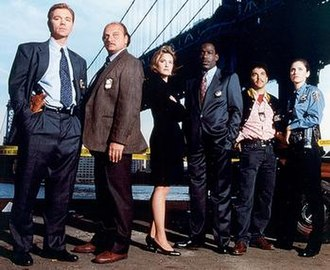 NYPD Blue - Original cast (from left): Caruso, Franz, Stringfield, McDaniel, Turturro, and Brenneman