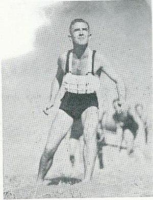 Piha Surf Life Saving Club - Cork filled rescue belt being used during training at Piha c. 1935