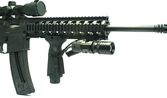 Tactical light - Flashlight mounted on a rifle.