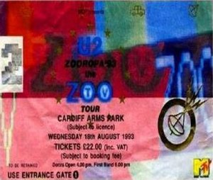 "Zoo TV Tour - The design of a 1993 ""Zooropa"" leg ticket reflects the tour's media oversaturation themes. The tour was co-sponsored by MTV, as shown in the ticket's bottom right corner."