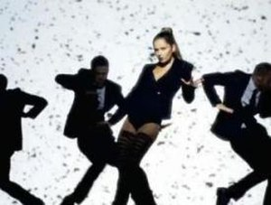 "Promise This - A frame from the video of ""Promise This"", where Cheryl Cole appears in a Madonna-esque black leotard."