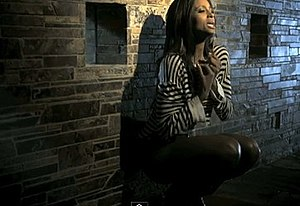 Speechless (Ciara song) - Ciara in front of a stone wall in the video.