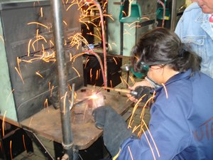 Sydney Secondary College Balmain Campus - Student operating a welder during a design and technology class