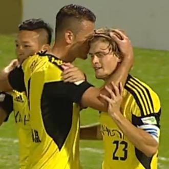 Jaimes McKee - McKee celebrates scoring with Admir Raščić and Deng Jinghuang in 2013.