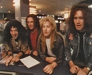 Bad News (band) - Bad News, in a scene from More Bad News. From left to right; Colin Grigson, Spider Webb, Vim Fuego, Den Dennis.