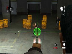 True Crime (series) - Precision targeting in the PlayStation 2 version of Streets of LA. The green reticule indicates the player can fire a non-lethal shot.