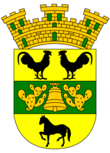 The Coat of Arms represents the Taínos.