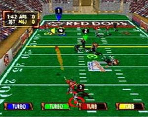 Kurt Warner's Arena Football Unleashed - A quarterback passes to one of his receivers.