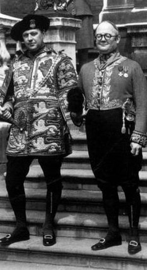 Colin Cole (officer of arms) - Sir Colin Cole standing with John Brooke-Little on the steps of the College of Arms on the occasion of the Prince of Wales' Investiture in 1969.