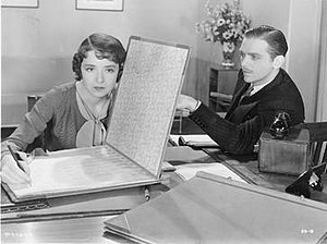 Success at Any Price - Film still of Colleen Moore and Douglas Fairbanks, Jr. from Success at Any Price.