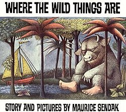 "The book cover is an illustration of a sail boat coming into a forested shore. On the shore, sleeping against a tree, is a giant furry monster with bare human feet and the head of a bull. Above the illustration, written in uneven block capital letters against a white background, is the title of the book ""Where the Wild Things Are"" and below the illustration, ""Story and pictures by Maurice Sendak""."