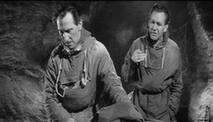 The Abominable Snowman (film) - John Rollason (Peter Cushing) and Tom Friend (Forrest Tucker) in a scene from The Abominable Snowman. The claustrophobic feel created by Val Guest in the film is evident.