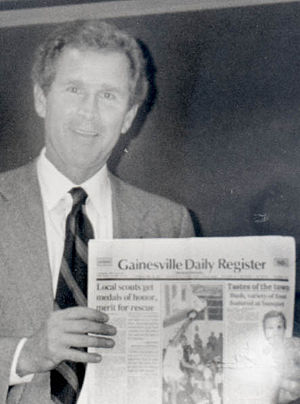 Gainesville Daily Register - Texas Gov. George W. Bush holds a copy of the Gainesville Daily Register during a visit to Gainesville, Texas, circa 1998.