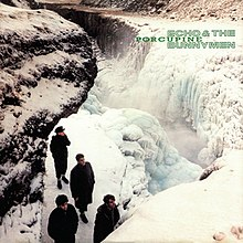 An album cover showing four men stood on a rocky outcrop with a frozen waterfall to their left. The band's and the album's names are in the top-left corner of the cover in green text.