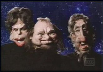Land of Confusion - The band members (Banks, Collins and Rutherford) as they appeared in the video.