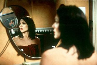 "Mulholland Drive (film) - The dark-haired woman (Harring) assumes the name ""Rita"" after seeing the name on a poster. Her search for her identity has been interpreted by film scholars as representing the audience's desire to make sense of the film."