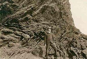 Walter Howchin - Howchin at an outcrop south of Hallett Cove, c. 1920