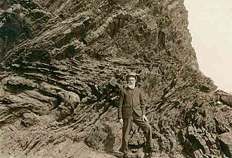 Walter Howchin - Howchin at an outcrop south of Hallett Cove, c. 1920