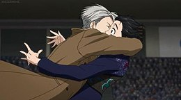 A screenshot from the show, depicting Victor apparently kissing Yuri K., who looks surprised