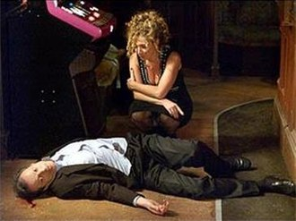 Den Watts - Chrissie kneeling over Den's corpse during the 20th anniversary episode. Consolidated figures reveal the episode was seen by over 17 million viewers (nearly 1/3 of the British population).