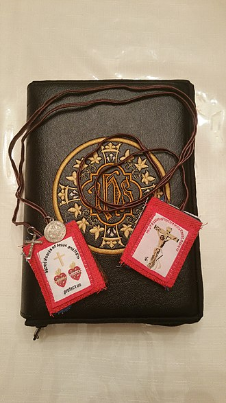 Fivefold Scapular - A Fivefold Scapular sits atop a copy of the Holy Bible.