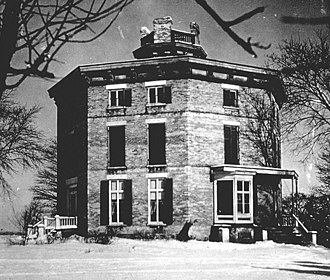 Octagon house - Photograph, date unknown. When record drawings were made, the house was dilapidated with the verandas missing: only an entrance porch can be seen here. The verandas were reinstated in 1973.