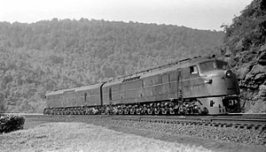 "Baldwin DR-12-8-1500/2 - ""Centipedes"" of the Pennsylvania Railroad are seen here returning around Horseshoe Curve to the bottom to await another assignment in July 1953. All PRR units were semi-permanently coupled back-to-back, in pairs."