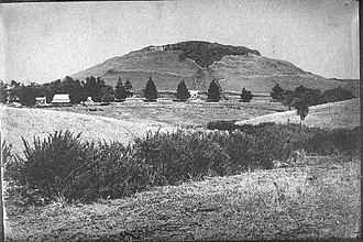 Mount Albert, New Zealand - Showing Mt Albert and the road or rail leading into the quarry, about 1905