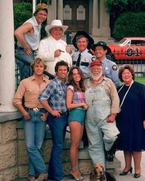 The Dukes of Hazzard - Cast of The Dukes of Hazzard (from left): (bottom) John Schneider, Tom Wopat, Catherine Bach, Denver Pyle, Peggy Rea; (top) Ben Jones, Sorrell Booke, James Best, Sonny Shroyer