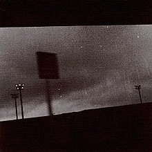A grainy black-and-white photo of billboards.