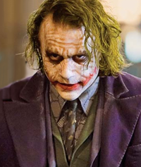 "Heath Ledger as the Joker.  The Joker's scruffy and grungy make-up is intended as a reflection of his ""edgy"" character."