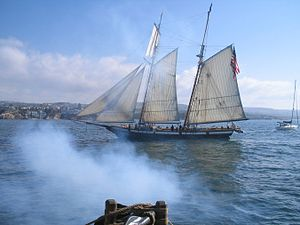 Battle of Rappahannock River - The reconstructed Lynx off California being saluted by Lady Washington.