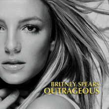 "The headshot of a young blonde woman. Her hair is blond and feathered straight. She is wearing lipstick and makeup. Her mouth is slightly open and her hand is pressed against her neck. In the bottom, the words ""Britney Spears"" are written in yellow italics. Below, the word ""Outrageous"" is written in the same fashion."