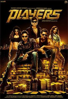 Five people are seen in the poster, three men and two women. Two of the men are sitting atop of gold bricks, holding guns. The other three are standing behind them. Both women are wearing revealing tops, showing their torso, one of them also has a gun in her hand.