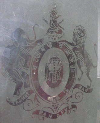 Rangpur, Bangladesh - The Coat of Arms of Maharaja Gopal Lal Roy as depicted on a ground floor French Door window panel.