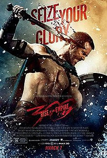 In this movie poster, a bare-chested Sullivan Stapleton in his role as Thermistocles is shown in the midst of battle, his face in combat rage. He carries a shield in his left hand, a bloodied short-sword in his right, and is stabbing downwards at an unseen enemy to the right. In the background floats the movie catch phrase: Seize Your Glory.