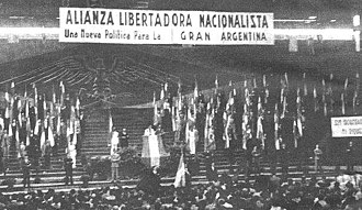 Nationalist Liberation Alliance - Congress of the Nationalist Liberation Alliance. The ALN symbol of the Andean condor clutching a hammer and a feather is on the background wall.
