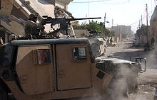 Picture of a soldier in a Humvee