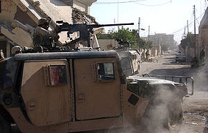 Battle of Samarra (2004) - A soldier in the turret of a Humvee fires a .50-caliber machine gun at the enemy in Samarra, Iraq, 1 October 2004.