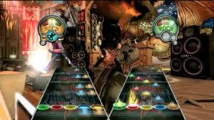 "Two ""note highways"" appear side by side, with colored notes moving towards the screen. A ""Rock meter"" is shown for each guitar to determine how many notes each guitar player has hit successfully."