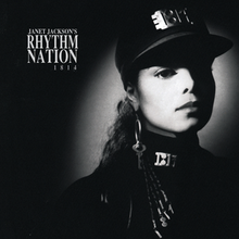 "A young woman photographed in black and white wears an all-black, military-styled uniform accented by silver-plated accessories. A spotlight shines on her face. To her left reads the text ""Janet Jackson's Rhythm Nation 1814""."