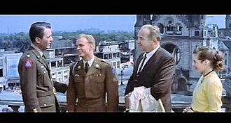 Night People (film) - Peck, Ted Avery, Crawford, Marianne Koch shown in front of the Kaiser Wilhelm Memorial Church in the American Sector of Occupied Berlin (R2 DVD CinemaScope version)