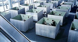 Playtime - The office set for Jacques Tati's Playtime anticipated the dominance of office cubicle arrangements by some 20 years.  The set was redressed for the trade exhibition sequence.