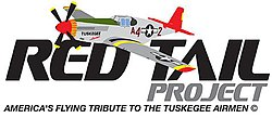 "Logo of the Red Tail Project with the words: ""RED TAIL"" in black letters above the left-aligned word PROJECT in gray letters which are half as tall all of which is above a motto reading: ""AMERICA's FLYING TRIBUTE TO THE TUSKEGEE AIRMEN"" (c), written in all caps, in a single line the same width as the first and much smaller letters. A single nosed-propeller aircraft with a red tail and nose, black propellers, gray base paint, black letters reading A42. The ""4"" and ""2"" are separated by a United States roundel in black with a central white star. The roundel is also visible on the tops of the aircraft's wings."