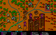 A battle, represented in digital format, takes place at a river intersection next to a small fortified city.  Trees, hills, brushes dot the area.  Simple colorful icons, representing monsters and soldiers, are arrayed among the terrain.  In certain locations, several icons are stacked as a pile.  A menu, displaying a list of commands, lies at the bottom of this image.
