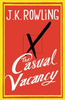 The first edition book cover. It is red with a yellow border. In the center is a square made be a thin black line. A thick x is drawn through it looking like it was made of black pen. Above in block letters it reads J.K. Rowling. Below the box and x it reads The Casual Vacancy in cursive.