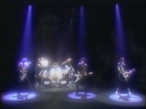 """A World Without Heroes - Kiss performing """"A World Without Heroes"""" in their 1981 video. Left to right: Gene Simmons, Eric Carr (on drums), Paul Stanley and Ace Frehley."""
