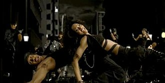 Get Up (Ciara song) - Ciara performing choreography with dancers in the music video, accompanied by a CGI cityscape.